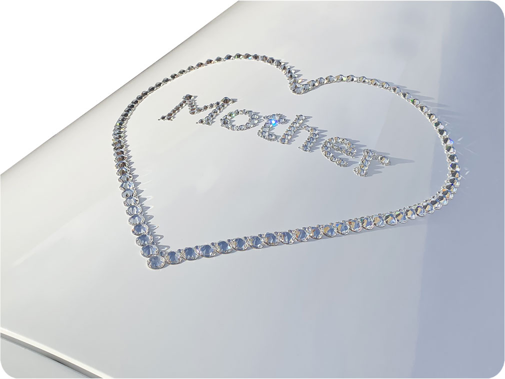 Purity American Casket with crystal wording over the lid